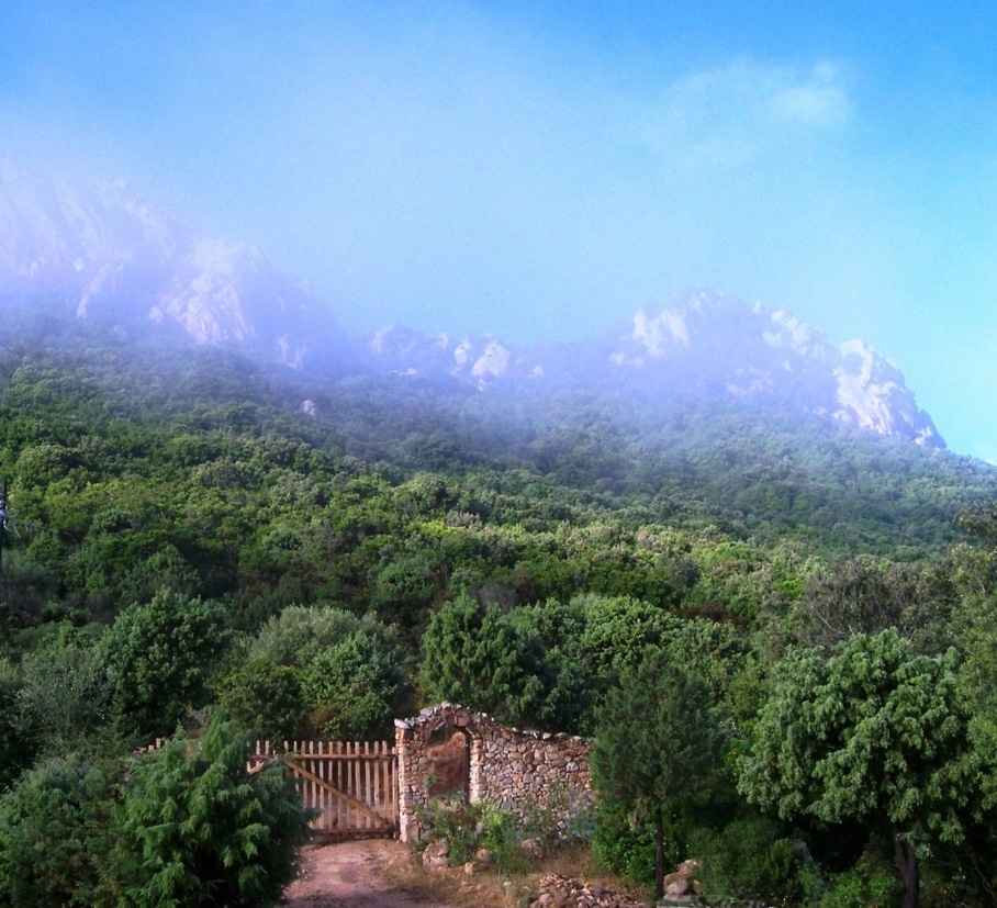 Entrance gate and mountain Cala Jami Sufi center Sardinia